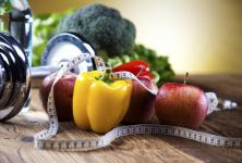 Fruits, vegetables, exercise equipment and measuring tape