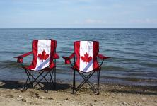 Two lawn chairs with Canadian Flags on them