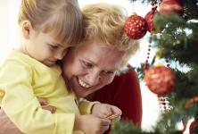 Grandma and child with Christmas tree