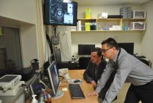 Doctors looking at images on computer screen.