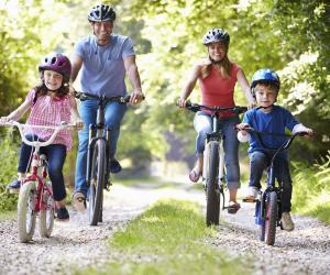 Happy family riding bikes